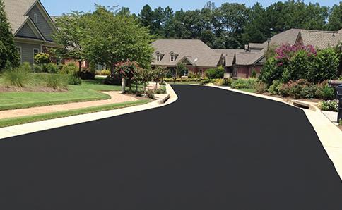 Road Sealer for asphalt pavement roads. Asphalt Sealcoat for Roads. OptiPave Surface Sealer and Rejuvenator for Roads and Streets. SealMaster.